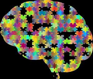 disabilità intellettive, un cervello colorato, comparti di puzzle mancanti